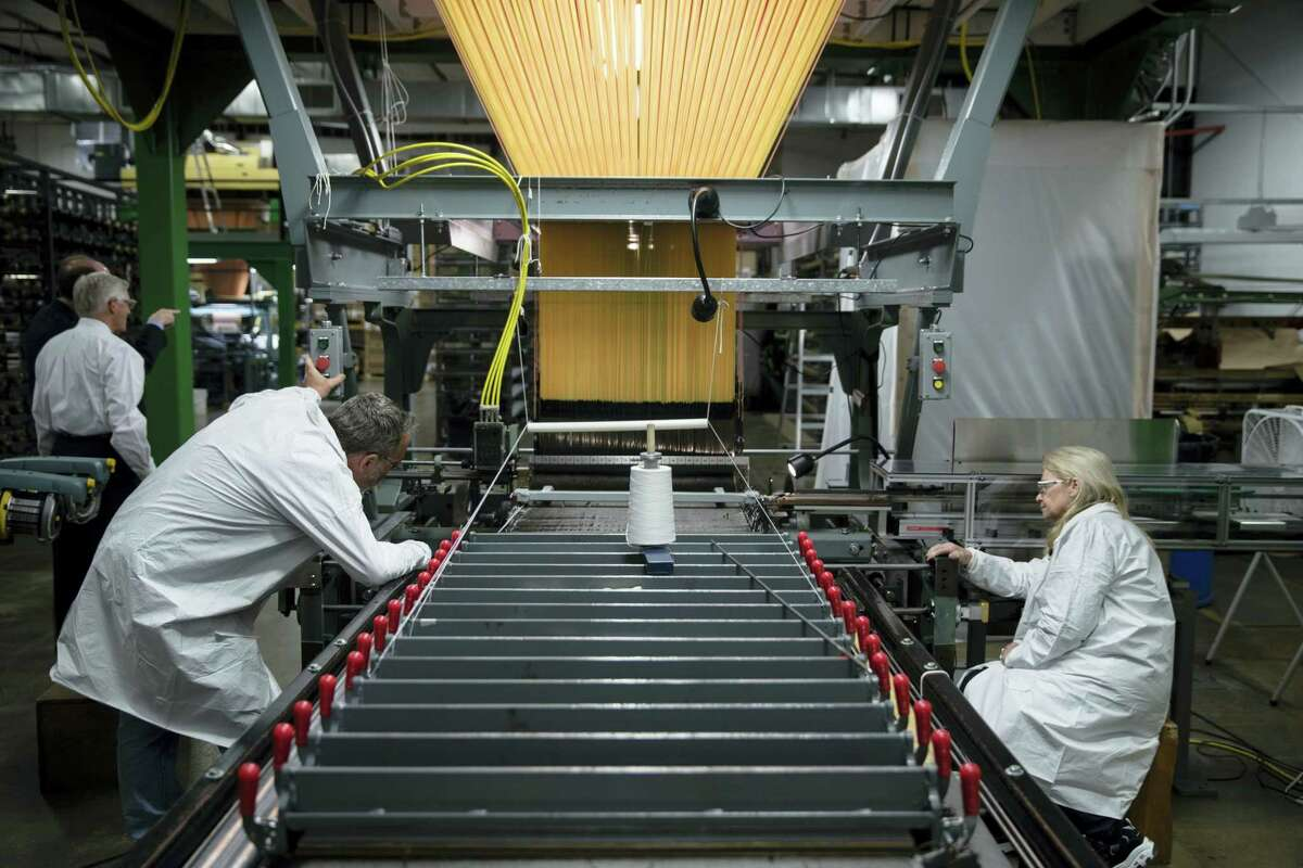 FILE - In this Thursday, March 23, 2017, file photo, workers manufacture thermal protection systems for NASA at Bally Ribbon Mills in Bally, Pa. U.S. employers pulled back on hiring in May 2017 by adding only 138,000 jobs. Hiring was still enough to help keep pushing unemployment lower.