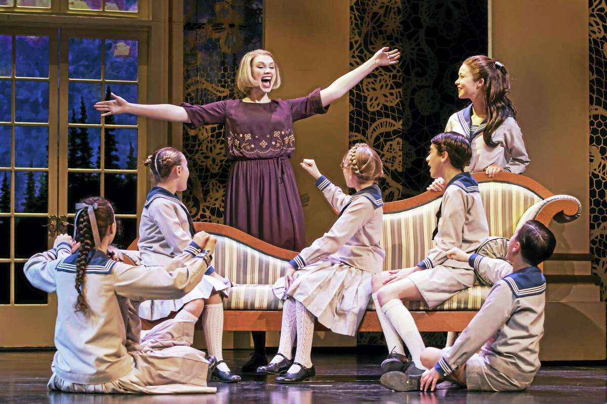 """Maria Rainer, played by Charlotte Maltby, leads the von Trapp children in song in a scene from """"The Sound of Music"""" at the Palace Theater."""