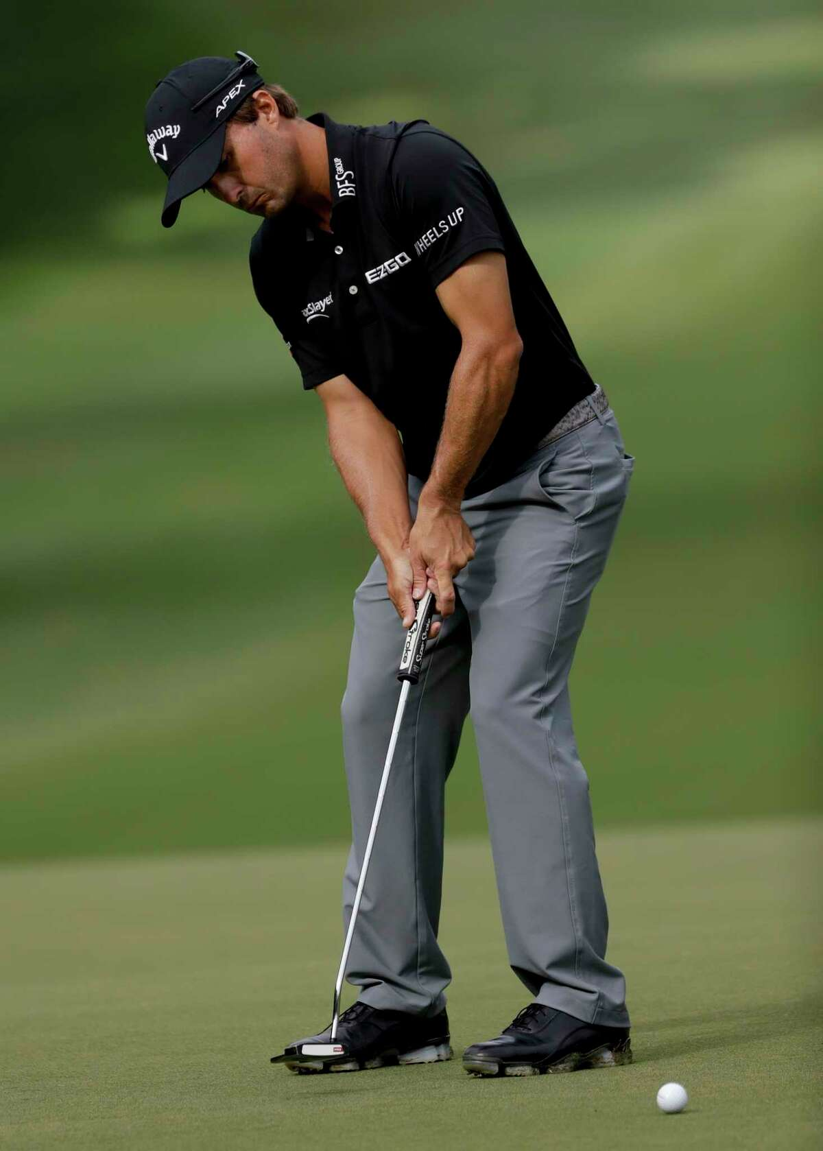 Kevin Kisner putts on the 12th hole during the second round of the PGA Championship golf tournament at the Quail Hollow Club Friday, Aug. 11, 2017, in Charlotte, N.C. (AP Photo/John Bazemore)