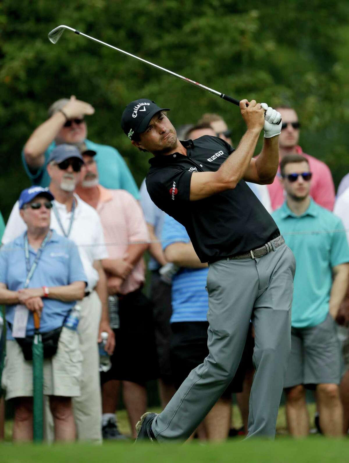 Kevin Kisner watches his tee shot on the 13th hole during the second round of the PGA Championship golf tournament at the Quail Hollow Club Friday, Aug. 11, 2017, in Charlotte, N.C. (AP Photo/John Bazemore)