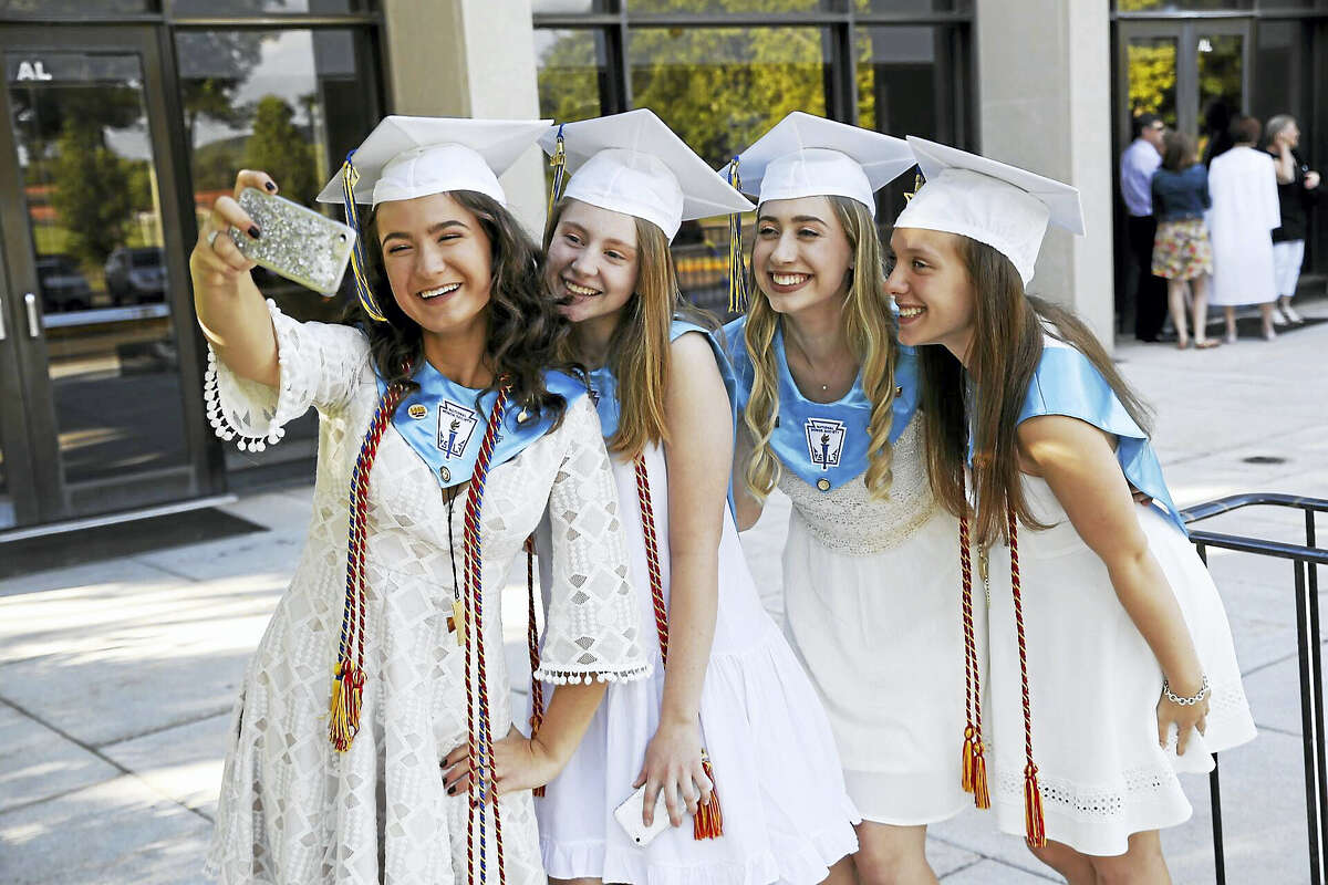 From left, Alexandra Porczak, 17, of Middletown, Abigail Baker, 18, of New Britain, Isabella Iorio, 18, of East Hampton, and Lauren Inglis, 18, take a selfie prior to graduation.