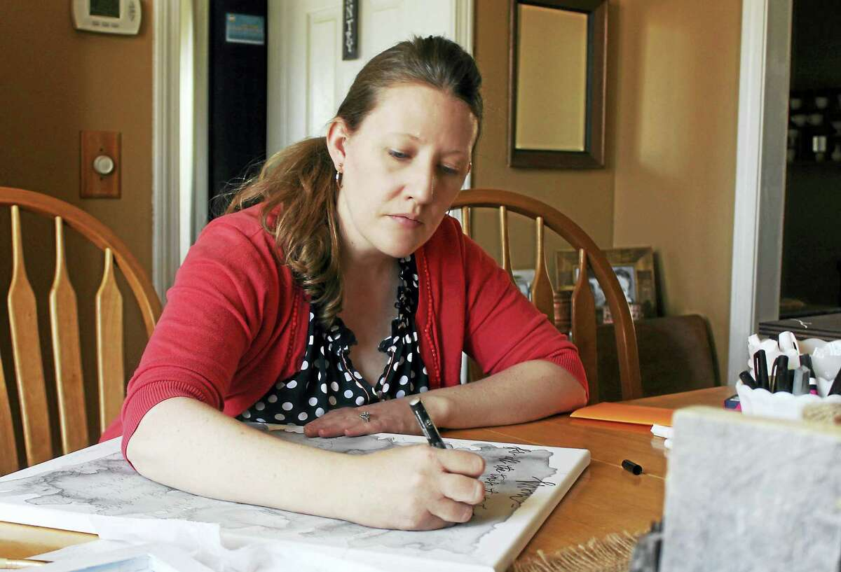 Kate Drew of Middletown creates a canvas for her Pretty and Printed line.