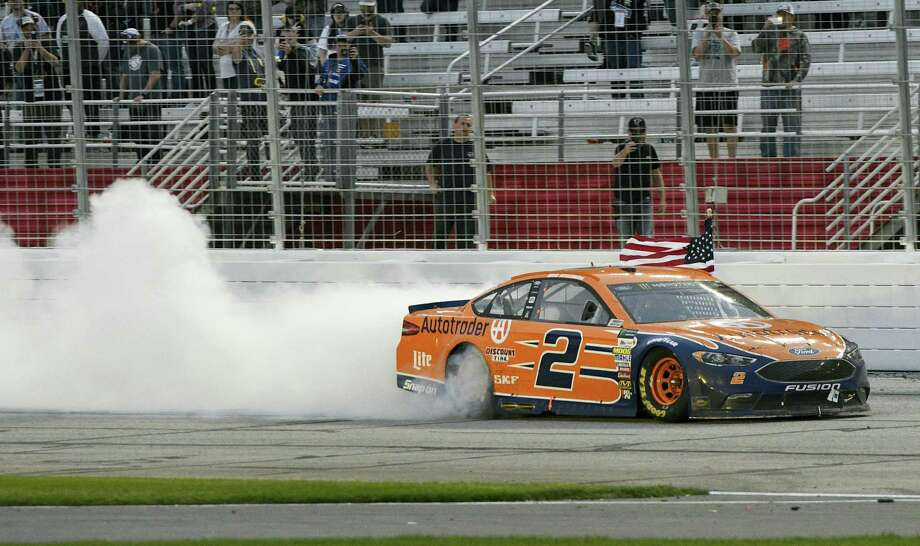Brad Keselowski passes the grandstand after winning at Atlanta Motor Speedway in Hampton, Ga., on Sunday. Photo: John Amis — The Associated Press  / FR69715 AP