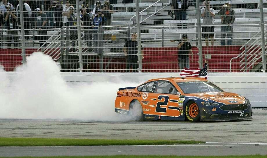 Brad Keselowski passes the grandstand after winning at Atlanta Motor Speedway in Hampton, Ga., on Sunday. Photo: John Amis — The Associated Press  / FR69715 AP