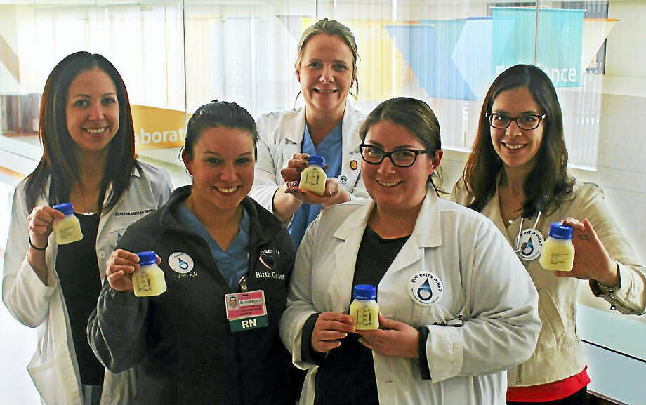 Through a grant from the Peach Pit Foundation of Durham, Middlesex Hospital in Middletown now offers pasteurized donor breast milk to breastfed babies whose nursing mothers need supplementation. From left are Laura Pittari, lead neonatal nurse practitioner; Jen Cote, registered nurse; Sarah Lennon, assistant nurse manager; and Brianna McNally, a lactation consultant; all of whom work at the Pregnancy & Birth Center; and pediatrician Lauren Melman. Photo: Contributed Photo