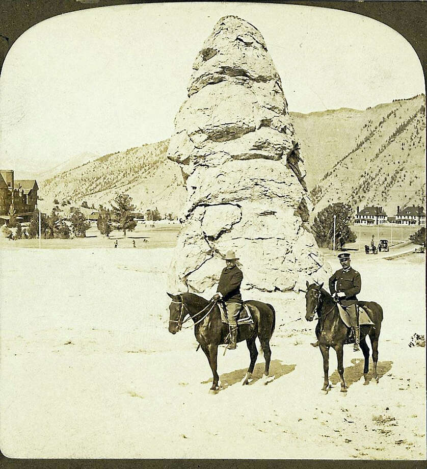 President Theodore Roosevelt, left, visits Liberty Cap in Yellowstone National Park. Photo: Library Of Congress  / The Washington Post