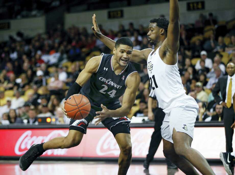 Cincinnati's Kyle Washington (24) scored 27 points in a Bearcats' win over the Huskies earlier this season. Photo: The Associated Press File Photo  / Reinhold Matay