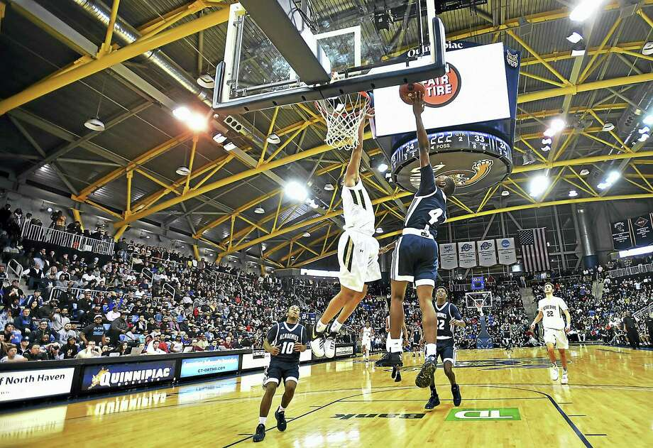 Wednesday night's matchup between Hillhouse and Notre Dame-West Haven was a sellout at Quinnipiac's TD Bank Sports Center. Photo: Catherine Avalone — Register  / Catherine Avalone/New Haven Register