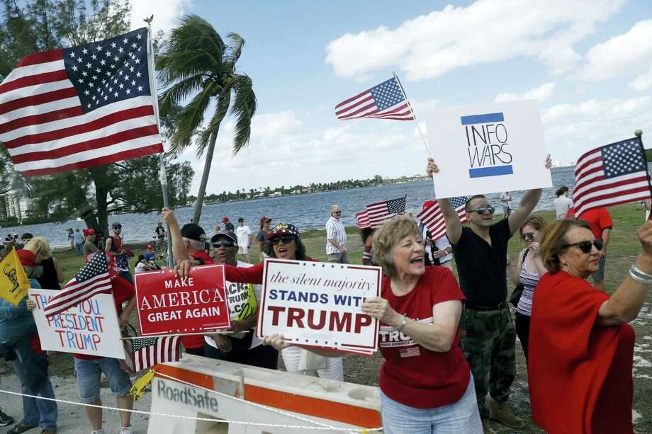 Supporters of President Donald Trump gather outside Mar-a-Lago, Saturday, March 4, 2017, in Palm Beach, Fla. Photo: AP Photo/Alex Brandon  / Copyright 2017 The Associated Press. All rights reserved.