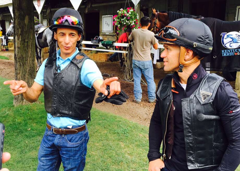 Doesn't matter where you go in Saratoga Springs during racing season, everyone is talking about horses. Two of the most recognizable jockeys on the Spa scene were doing just that Friday morning outside of trainer Todd Pletcher's barn on the Oklahoma Training Track. John Velazquez, left, and Javier Castellano had just worked two of Pletcher's big horses and then were talking about Always Dreaming (Velazquez) and Outplay (Castellano). Both horses could be on the fast track to run in the Travers Stakes here on Aug. 26. (Tim Wilkin / Times Union)