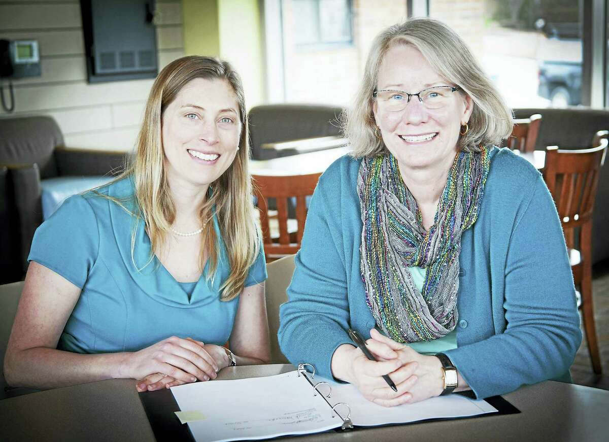 Post University Academic Provost Elizabeth Johnson, left, and Middlesex Community College President Anna Wasescha sign an articulation agreement in Middletown.