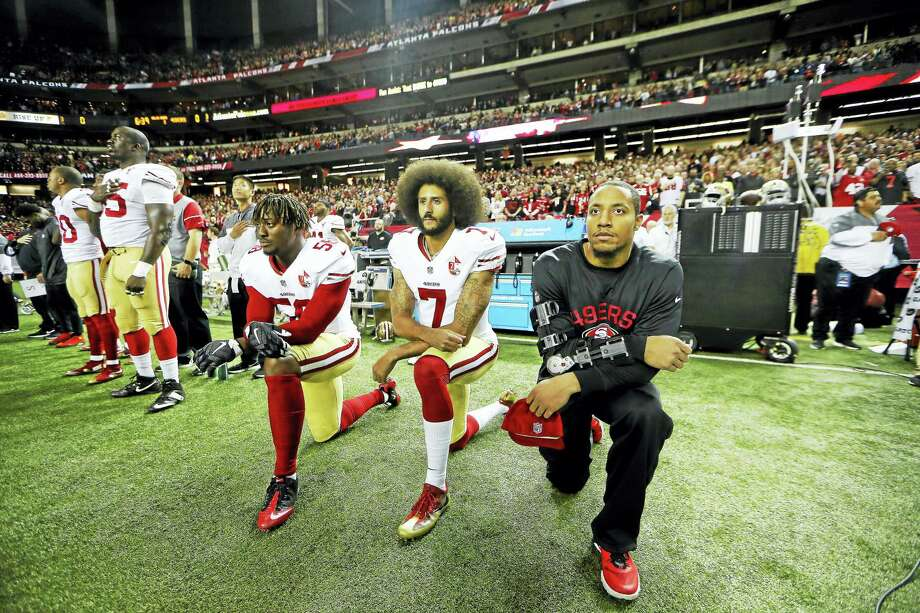 San Francisco 49ers quarterback Colin Kaepernick (7) and San Francisco 49ers outside linebacker Eli Harold (58) kneel during the playing of the national anthem before a game last season in Atlanta. Photo: The Associated Press File Photo  / Copyright 2016 The Associated Press. All rights reserved.