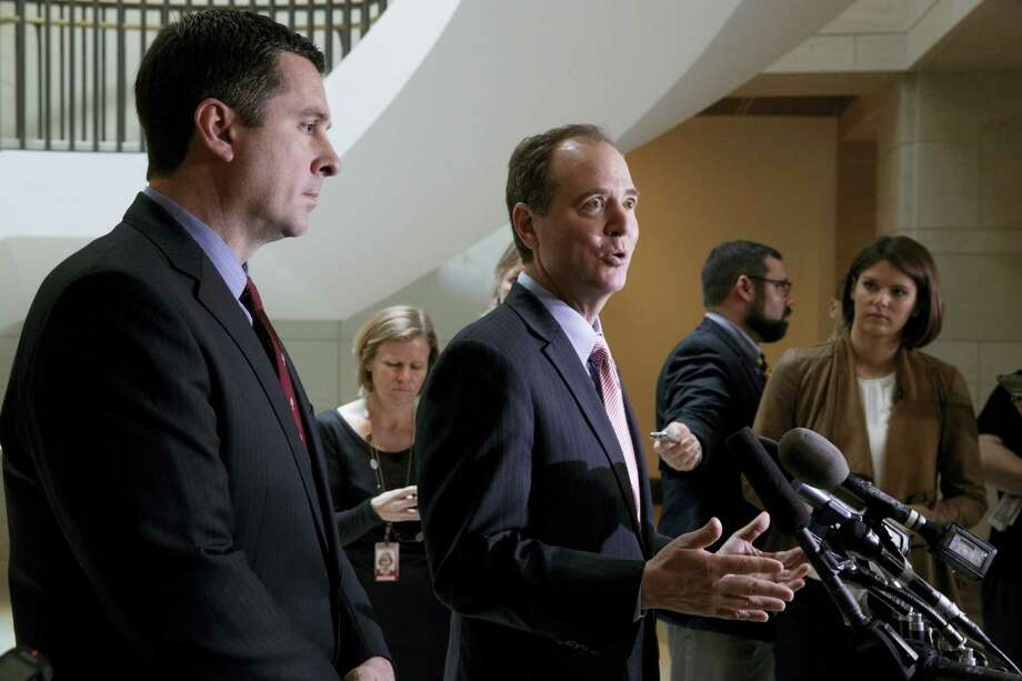 House Intelligence Committee Chairman Rep. Devin Nunes, R-Calif. listens at left, as the committee's ranking member Rep. Adam Schiff, D-Calif., talk to reporters on Capitol Hill in Washington, Thursday, March 2, 2017, following their meeting with FBI Director Jim Comey about Russian influence on the American presidential election. Photo: AP Photo/J. Scott Applewhite   / AP