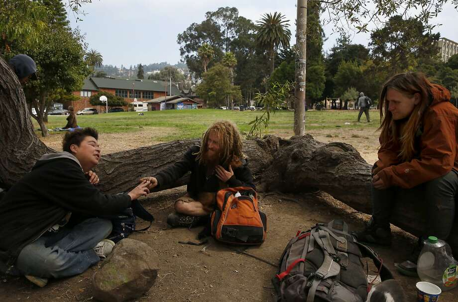 From left, Peaches, who has lived in the park for 12 years, Gnome and Erin smoke and hang out in People's Park August 11, 2017 in Berkeley, Calif. Photo: Leah Millis, The Chronicle
