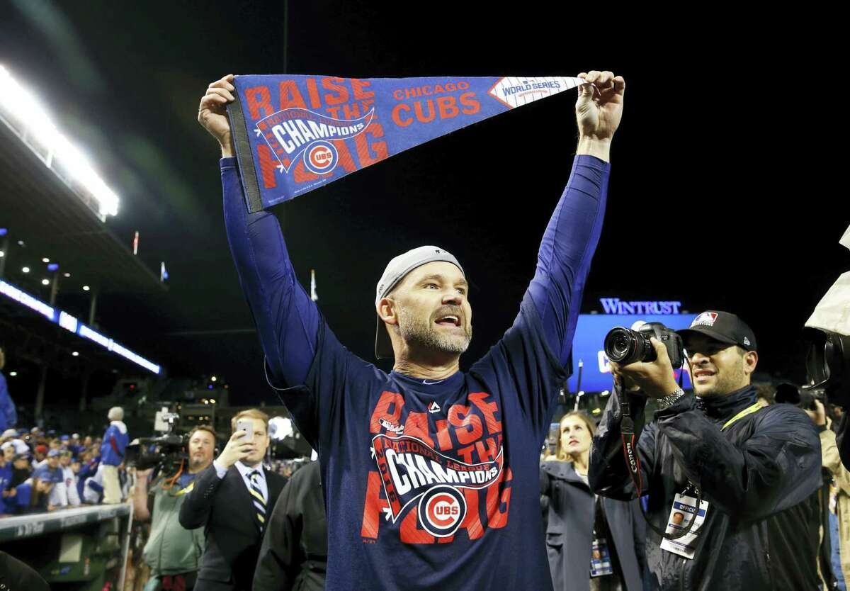 Former Chicago Cubs catcher David Ross celebrates after a playoff win.