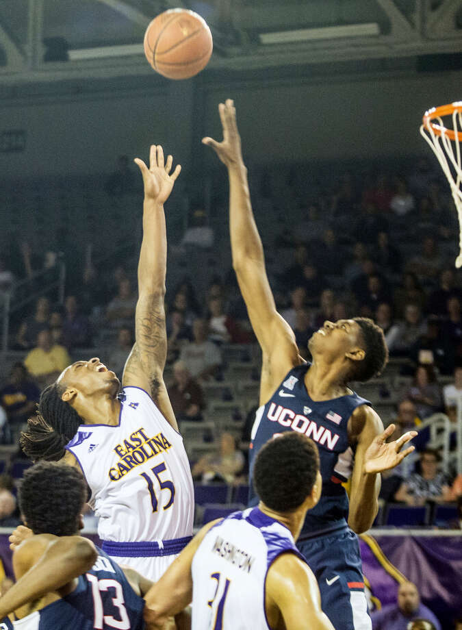East Carolina's Kentrell Barkley, left, shoots over UConn's Juwan Durham on Wednesday in Greenville, N.C. Photo: Joe Pellegrino — The Daily Reflector Via AP  / Joe Pellegrino/The Daily Reflector