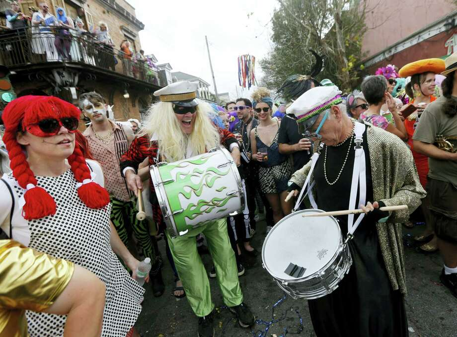 Revelers play music at the start of the Society of Saint Anne Mardi Gras parade in New Orleans on Feb. 28, 2017. Photo: AP Photo — Gerald Herbert  / Copyright 2017 The Associated Press. All rights reserved.