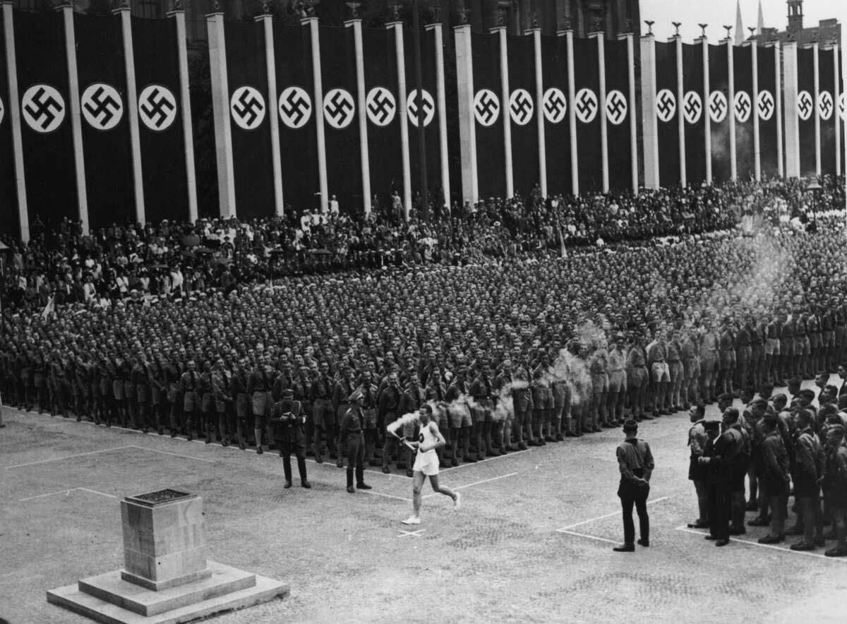 Nazi Germany Olympics Two years before the Nazis came to power in Germany, Berlin was selected to host the 1936 Summer Olympics. As the Olympics approached, many countries, including the U.S., considered boycotting the Olympics due to Nazi ideas of racial superiority.