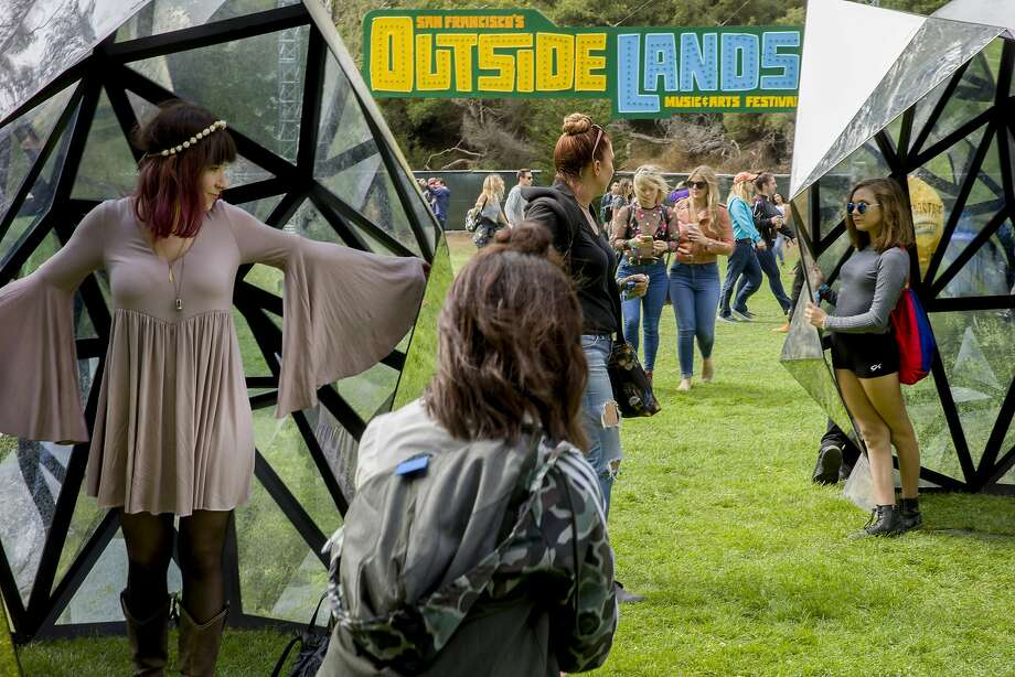 From left: Alexz Crase and Kayla Pacioni check out the art at the Outside Lands music festival at Golden Gate Park on Friday, Aug. 11, 2017, in San Francisco, Calif. Photo: Santiago Mejia, The Chronicle