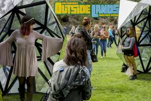 From left: Alexz Crase and Kayla Pacioni check out the art at the Outside Lands music festival at Golden Gate Park on Friday, Aug. 11, 2017, in San Francisco, Calif.