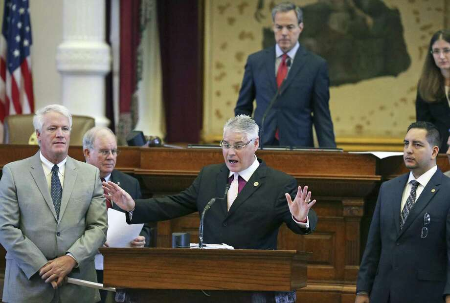 Rep. Dan Huberty, R-Kingwood, defends against an amendment to his annexation bill as the House considers  military buffer zones and othe annexation issues during the legislative process on August 11, 2017. On the left is Rep. Lyle Larson, R-San Antonio;  on the right is Rep. Philip Cortez, D-San Antonio.  Speaker of the House Joe Straus listens from the bench behind. Photo: Tom Reel, Staff / San Antonio Express-News / 2017 SAN ANTONIO EXPRESS-NEWS