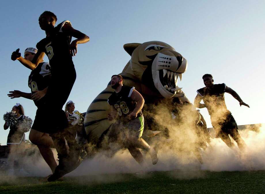 Conroe football players run onto the field during the annual Tiger Roar event at Buddy Moorhead Stadium, Friday, Aug. 11, 2017, in Conroe. Photo: Jason Fochtman, Staff Photographer / © 2017 Houston Chronicle