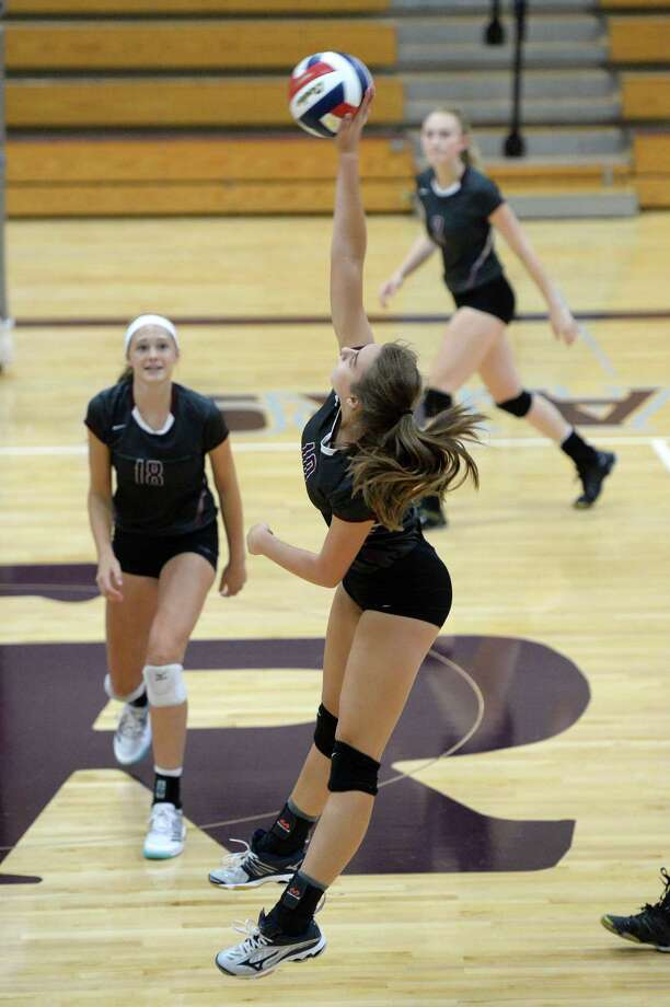 Haley Payne (10) of Cinco Ranch attempts a kill shot in the second set of a high school volleyball game between the Cinco Ranch Cougars and the Aldine Mustangs during the 2017 Cy-Fair ISD/Katy ISD Classic on August 10, 2017 at Cinco Ranch High School, Katy, TX. Photo: Craig Moseley, Staff / ©2017 Houston Chronicle