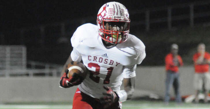 Crosby's Craig Williams looks for running room against New Caney at Texan Drive Stadium on Friday.