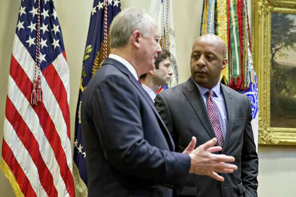 WASHINGTON, D.C. - FEBRUARY 15:  (AFP-OUT) Marvin Ellison, Chairman and Chief Executive Officer of J.C. Penny Co. Inc., right, talks to Greg Sandfort, Chief Executive Officer officer of Tractor Supply Co., before a listening session with President Donald Trump and the Retail Industry Leaders Association in the Roosevelt Room of the White House on February 15, 2017 in Washington, D.C. Questions about ties between Trump's team and Russian intelligence agents mounted Wednesday after news of extensive contacts between the two were reported. Democrats and some Republicans are calling for an investigation into Trump's links to Russia. (Photo by Andrew Harrer-Pool/Getty Images)