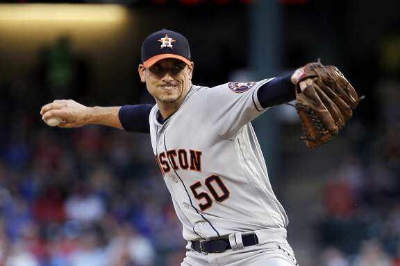 Houston Astros starting pitcher Charlie Morton throws to the Texas Rangers during the first inning of a baseball game, Friday, Aug. 11, 2017, in Arlington, Texas. (AP Photo/Tony Gutierrez)