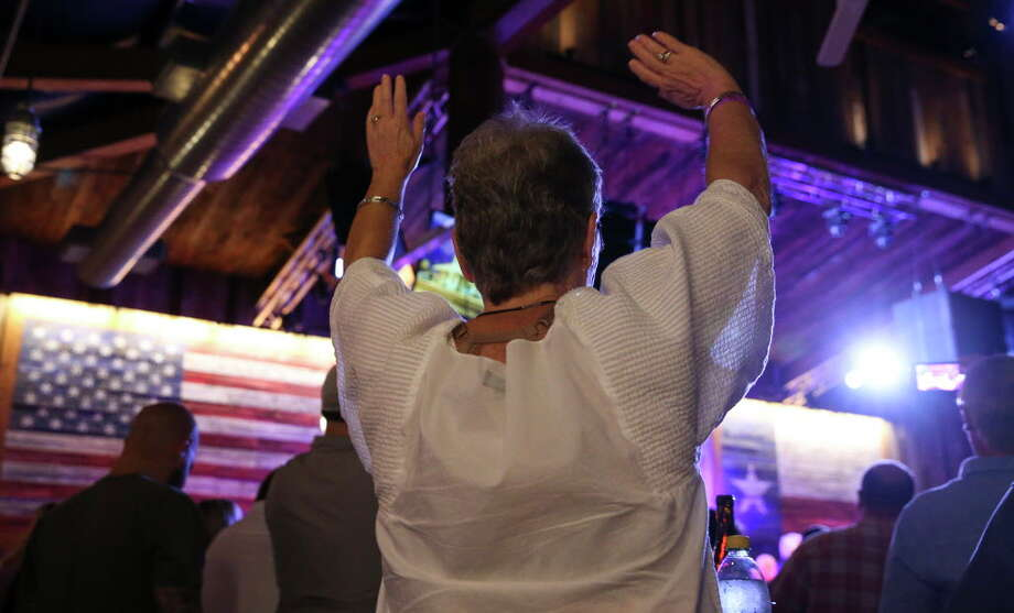 A fan waves and dances with the song that singer Kenny Rogers is performing at the Redneck Country Club Friday, Aug. 11, 2017, in Stafford. Rogers plans to give his last concert in October in Nashville, which made his Friday show his final performance in his hometown of Houston. Photo: Yi-Chin Lee, Houston Chronicle / © 2017  Houston Chronicle