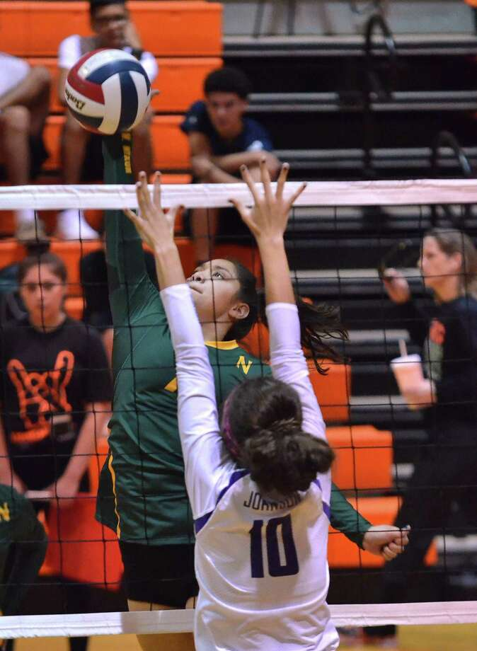 Nixon's Atiana Adriano helped the Lady Mustangs remain unbeaten on the season with a 3-0 day at the Donna Tournament on Friday. Photo: Cuate Santos / Laredo Morning Times File / Laredo Morning Times