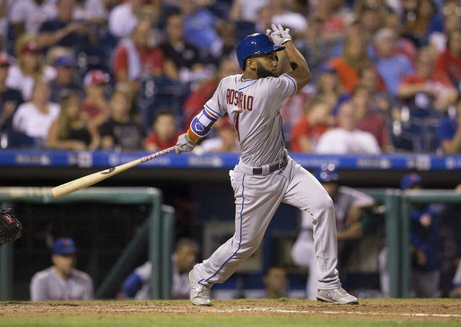 PHILADELPHIA, PA - AUGUST 11: Amed Rosario #1 of the New York Mets hits a solo home run in the top of the ninth inning against the Philadelphia Phillies at Citizens Bank Park on August 11, 2017 in Philadelphia, Pennsylvania. The Mets defeated the Phillies 7-6. (Photo by Mitchell Leff/Getty Images) ORG XMIT: 700011982 Photo: Mitchell Leff / 2017 Getty Images