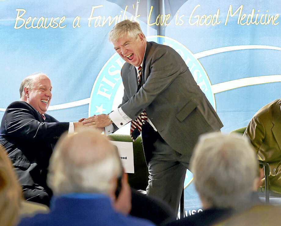 Gerald Culliton, director of the VA Connecticut Healthcare System, left, and Kevin Creed, volunteer CEO, director and founder of Friends of Fisher House Connecticut, share a laugh during the VA Connecticut Healthcare System Fisher House ground-breaking ceremony Tuesday in West Haven. Photo: Peter Hvizdak — New Haven Register  / ©2017 Peter Hvizdak