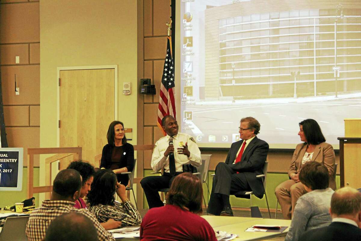 New Haven Interim Police Chief Anthony Campbell speaks at a Second Chance event at Gateway Community College Thursday, flanked by U.S. Attorney Deirdre Daly, left, U.S. District Judge Jeffrey Meyer and Jen Amato of the federal probation office.