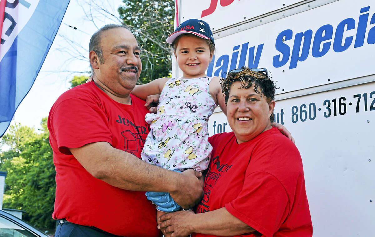 Open since April, Jennifer's Breakfast & Lunch at 70 N. Main St. in Middletown's North End has been doing brisk business. From left are Middletown residents Rafael Avila, granddaughter Amelia Sibley, 4, and Avila's wife and Jennifer's owner, Debbie Avila.