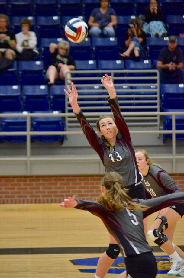 Lee's Jensen Letcher (13) sets up a ball for teammates Kelsey Harrington (5) and Elexa Gillette (10) during a match Friday at the Mansfield ISD Tournament. Shay Hillman/Special to the Reporter-Telegram