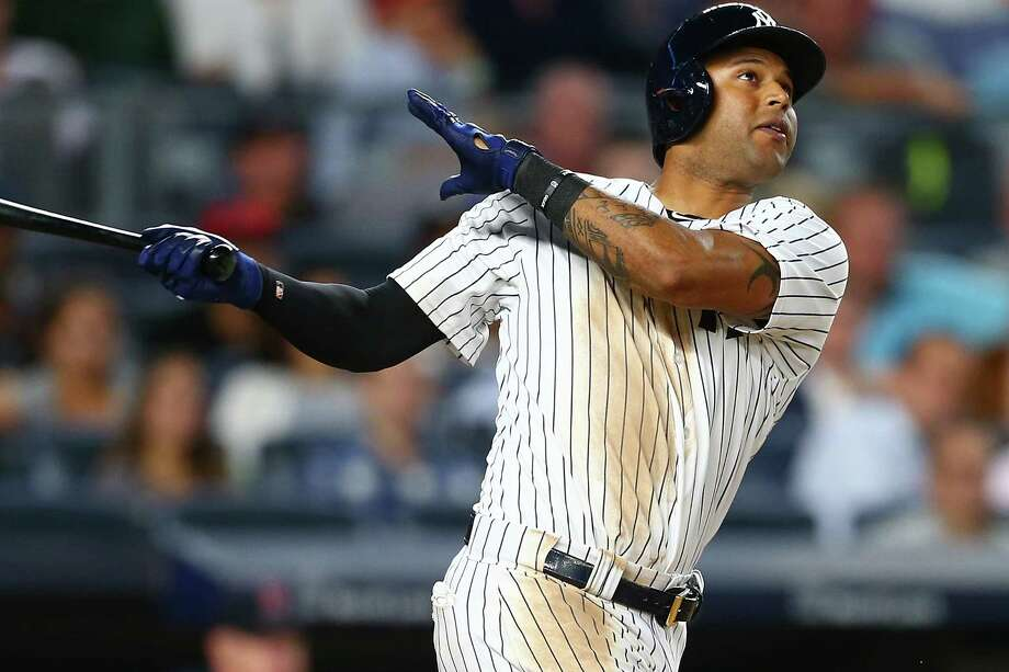 NEW YORK, NY - AUGUST 11:  Aaron Hicks #31 of the New York Yankees connects on a 2-run home run in the eighth inning against the Boston Red Sox at Yankee Stadium on August 11, 2017 in the Bronx borough of New York City.  (Photo by Mike Stobe/Getty Images) ORG XMIT: 700011978 Photo: Mike Stobe / 2017 Getty Images