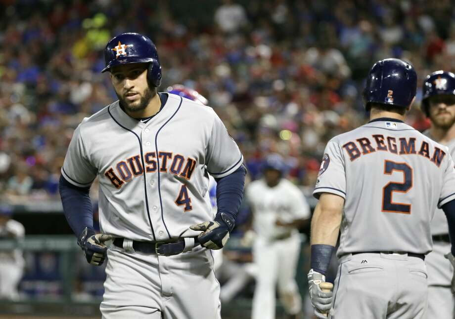 Houston Astros' George Springer (4) is congratulated by Alex Bregman (2) after Springer hit a two-run home run off Texas Rangers relief pitcher Jose Leclerc during the eighth inning of a baseball game, Friday, Aug. 11, 2017, in Arlington, Texas. The Rangers won 6-4. (AP Photo/Tony Gutierrez) Photo: Tony Gutierrez/Associated Press