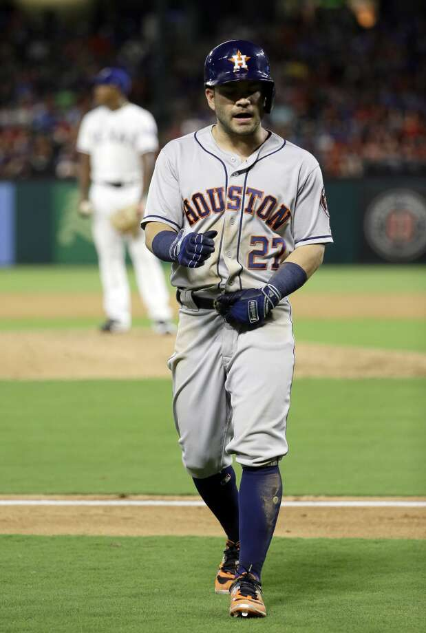 Houston Astros' Jose Altuve jogs back to the dugout after hitting into a double play, on a pitch fromTexas Rangers reliever Jose Leclerc, rear, during the eighth inning of a baseball game, Friday, Aug. 11, 2017, in Arlington, Texas. (AP Photo/Tony Gutierrez) Photo: Tony Gutierrez/Associated Press