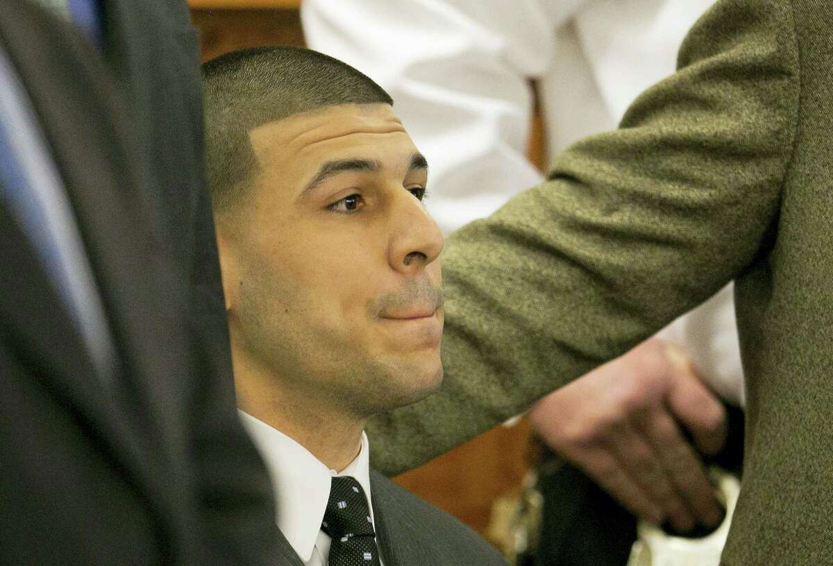 Former New England Patriots football player Aaron Hernandez listens as the guilty verdict is read during his murder trial in 2015 at Bristol County Superior Court in Fall River, Mass.