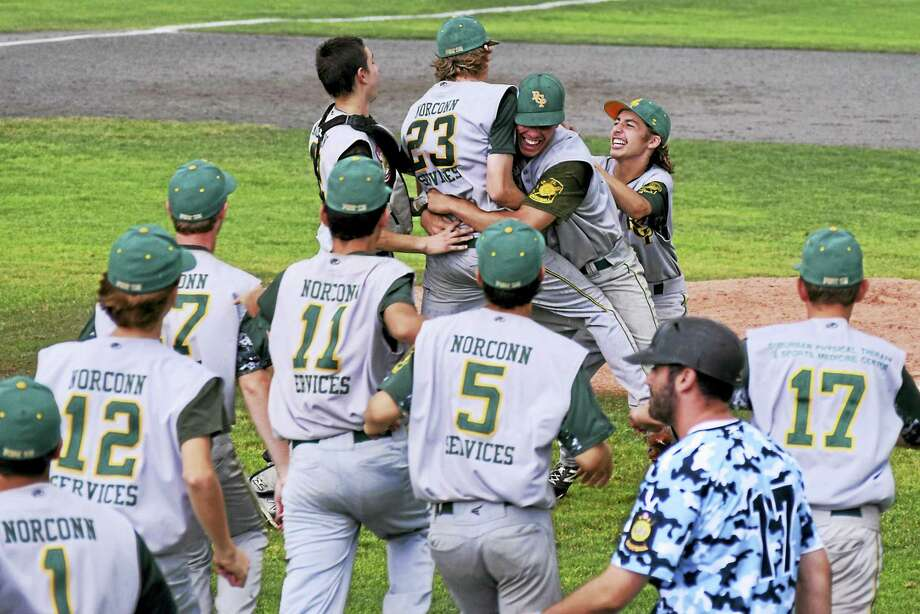 RCP players celebrate on the mound after Austin Roy (23) tossed a no-hitter in Saturday's Junior Legion state championship game at Palmer Field. Photo: Derek Turner - Special To The Middletown Press