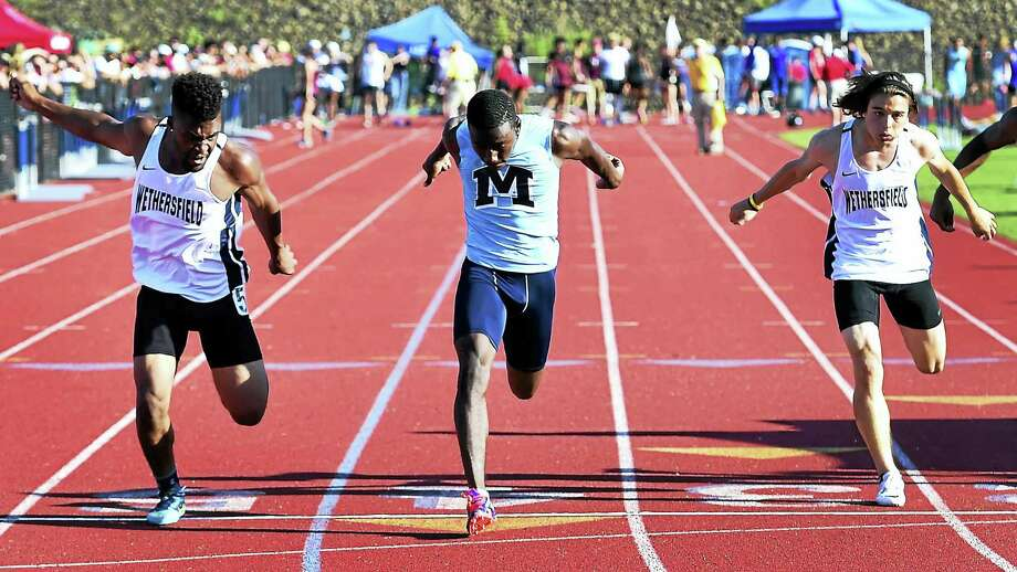 Deshaun Bradshaw of Middletown High wins the CIAC Class L Championship 100-meter dash Tuesday at Middletown High School. Photo: Peter Hvizdak — New Haven Register  / ©2016 Peter Hvizdak