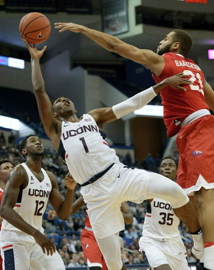 UConn's Christian Vital shoots as Boston University's Cedric Hankerson, right, defends, in the second half of the Huskies' 51-49 win Wednesday at the XL Center. Photo: JESSICA HILL — THE ASSOCIATED PRESS  / AP2016