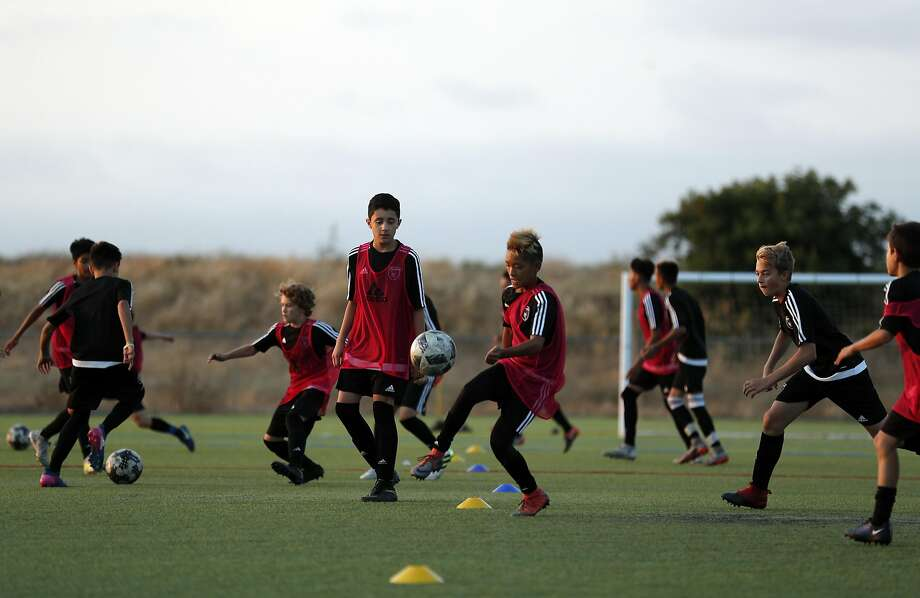 Boys in the U-14 group, one of six age-specific teams at the San Jose Earthquakes Academy, run drills in Sunnyvale. Photo: Carlos Avila Gonzalez, The Chronicle