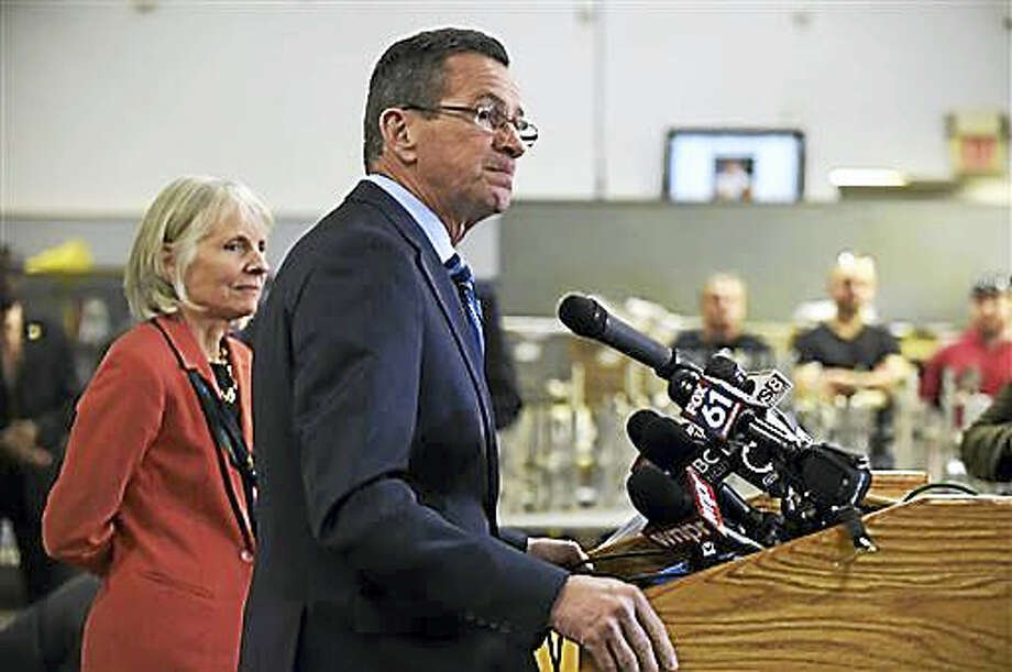 Gov. Dannel P. Malloy announces General Electric's decision to move their world headquarters to Boston on Jan. 13, 2016 in Middletown, Conn. At left is Catherine Smith, Commissioner of the Connecticut Department of Economic and Community Development. Photo: Patrick Raycraft/Hartford Courant Via AP