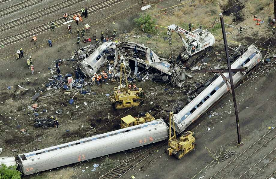 In this May 13, 2015 photo, emergency personnel work at the scene of a Tuesday night derailment in Philadelphia of an Amtrak train headed to New York. Federal investigators are expected to release interview transcripts, locomotive data and other evidence Monday, Feb. 1, 2016 that could help clear up the mystery of why the train streaked into a sharp curve at double the speed limit. Photo: AP Photo/Patrick Semansky, File  / AP