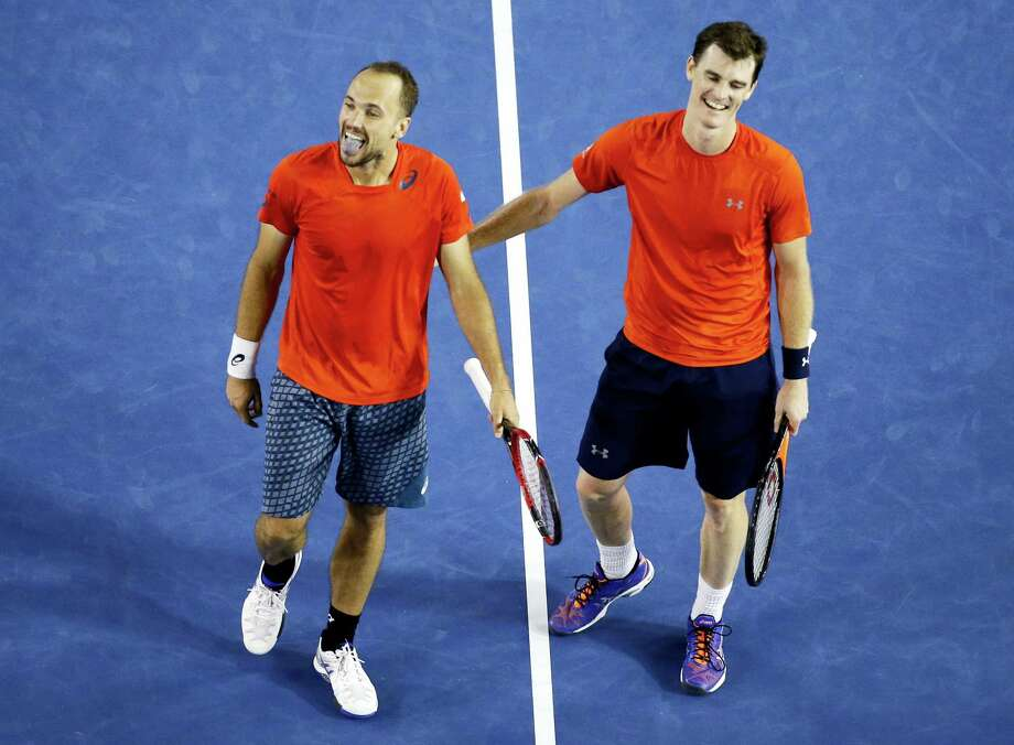 Jamie Murray, right, of Britain and Bruno Soares of Brazil  celebrate after defeating Daniel Nestor of Canada and Radek Stepanek of the Czech Republic in the men's doubles final at the Australian Open tennis championships in Melbourne, Australia, early Sunday, Jan. 31, 2016.(AP Photo/Vincent Thian) Photo: AP / AP