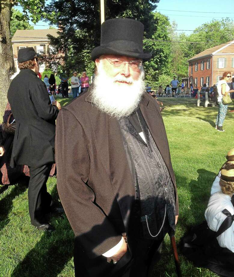 A member of the Cromwell Historical dresses in attire from the Civil War era during last year's Memorial Day parade. This weekend's ball will feature period music, food and dancing. Photo: File Photo