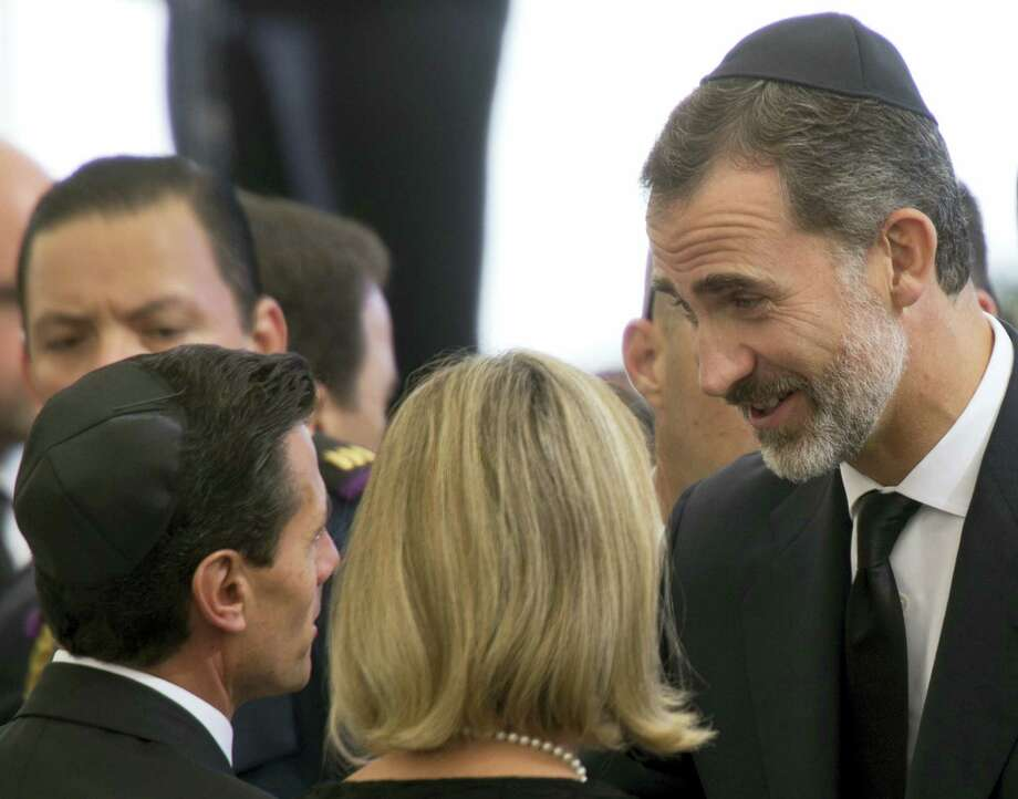 Spain's King Felipe VI, right, talks to other invited guests as he arrives for the funeral of the late Israeli President Shimon Peres at the Mount Herzel national cemetery in Jerusalem, Friday, Sept. 30, 2016. Photo: AP Photo/Ariel Schalit   / Copyright 2016 The Associated Press. All rights reserved.